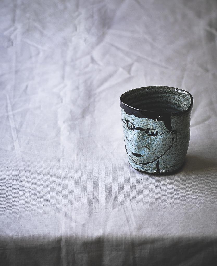 Ceramic Light Blue Face Cup