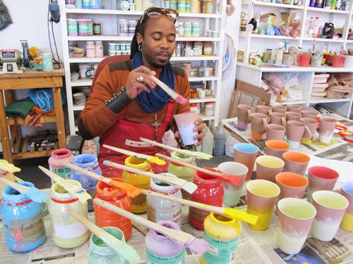 Sandile Cele painting the colourful range