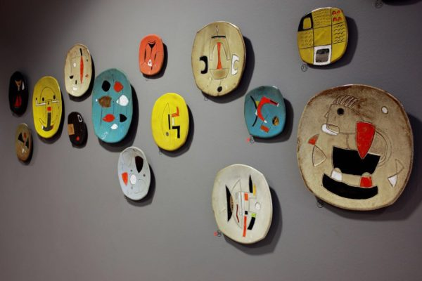 Wall plates by Clementina in a Solo exhibition - Poetry in African Clay at Ebony gallery